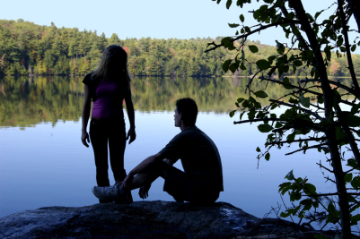 couple-talking-by-lake